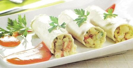 Canelones de merluza y gambas con salsa de tomate